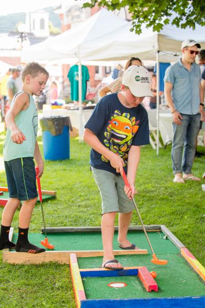 kids playing golf at DCEC's Family Fun Day